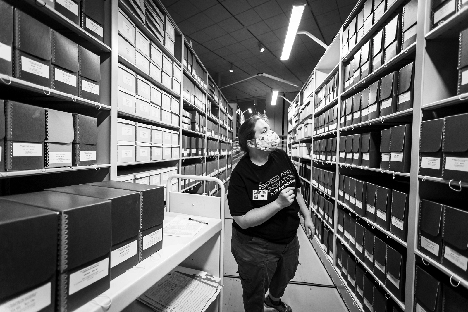 Rachel, the Museum's Information Specialist, searching the archives.